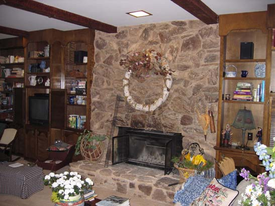 Before photo of a basic stone fireplace