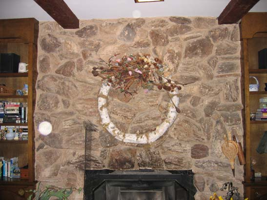 Before close up shot of a basic stone fireplace